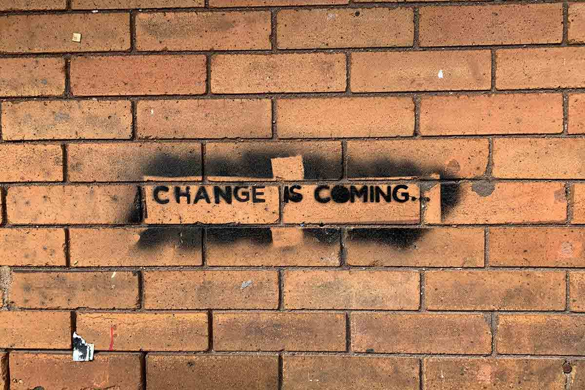 "stencil that reads ""Change is coming"" from the wall of Cup Foods, photographed on October 16, 2020"