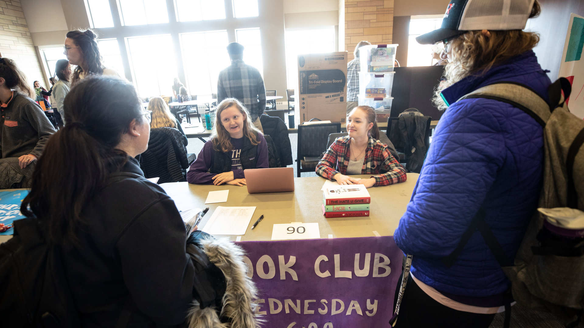 Members of the Book Club talk to students during an Activities Fair