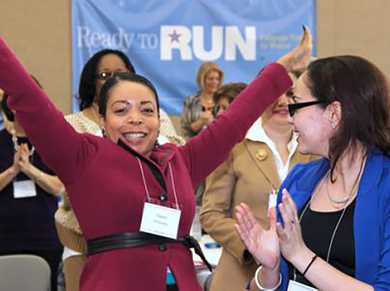 Women celebrate at the ready to run event.