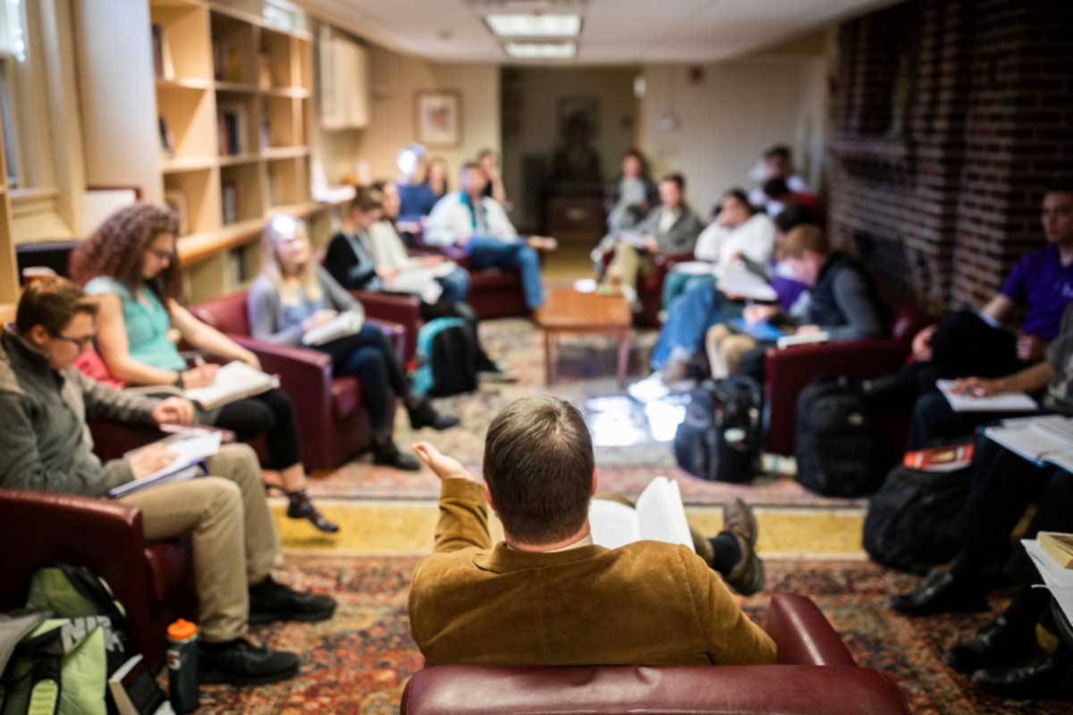 Catholic Studies discussion in Sitzmann Hall library.
