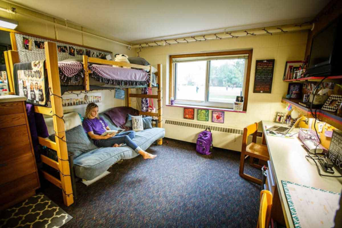 A student studies in her residence hall room.