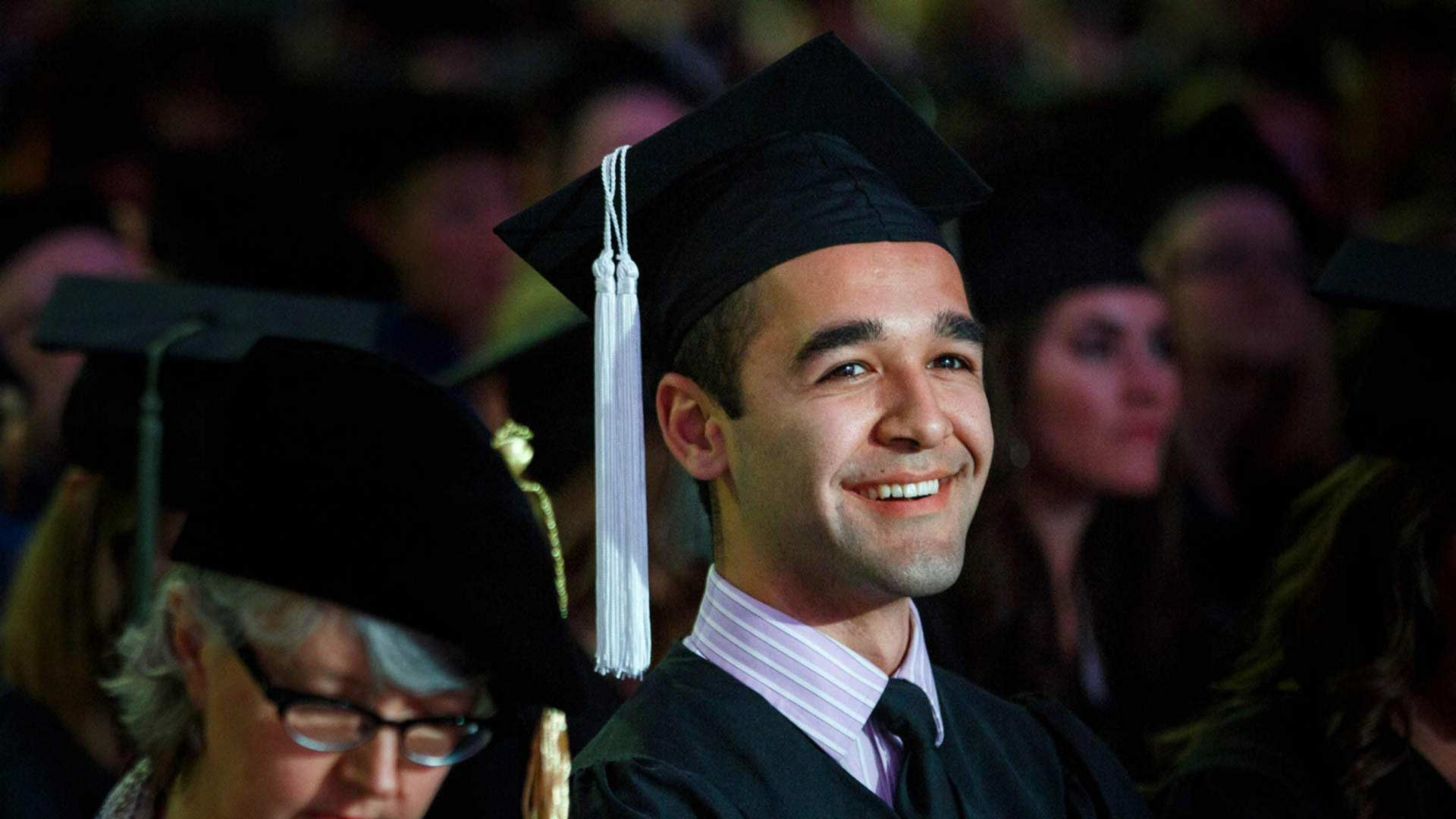 Photo of a Latino man at college graduation.