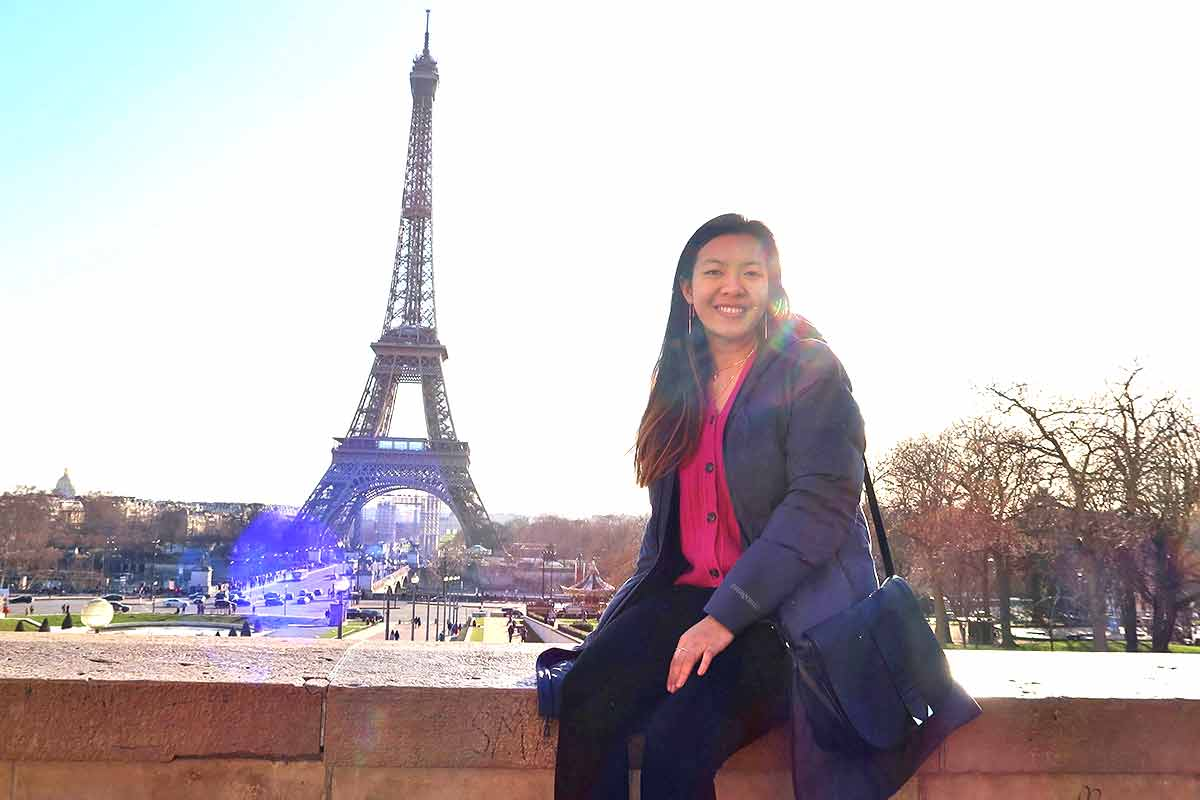 Brenda Huang in front of the Eiffel Tower
