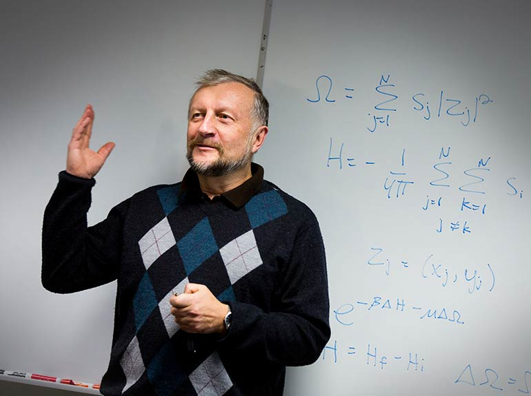 Professor Arkady Shemyakin speaks during presentations in one of his statistics courses.