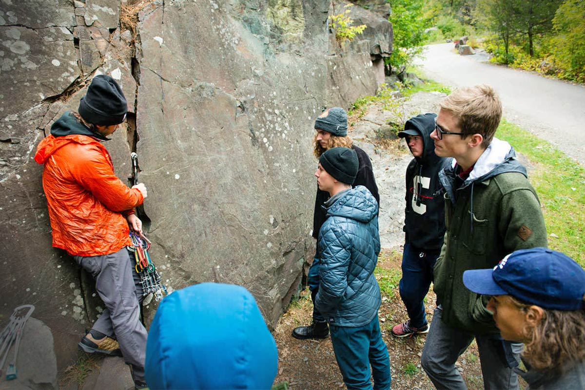 Geology students examine a rock face in Taylors Falls, Wisconsin.