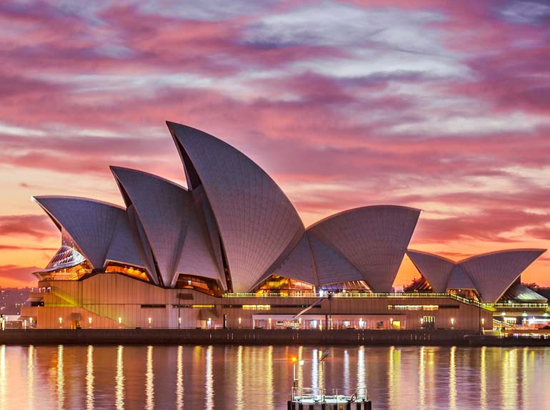 Stock photo of the Sydney Opera House in Sydney, Australia at sunset.