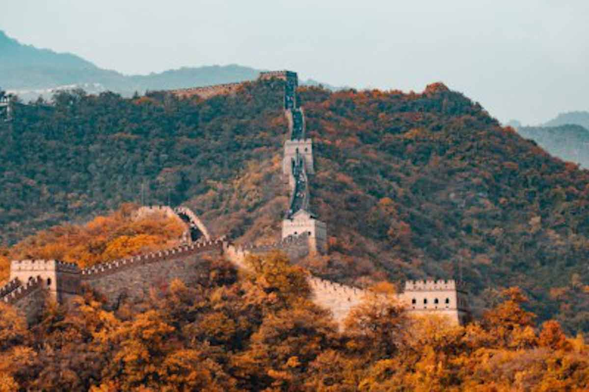 Photo of the Great Wall of China on a fall day at dusk.