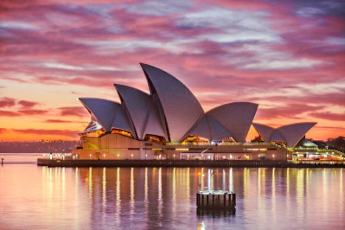 Photo of the Sydney Opera House at sunset.