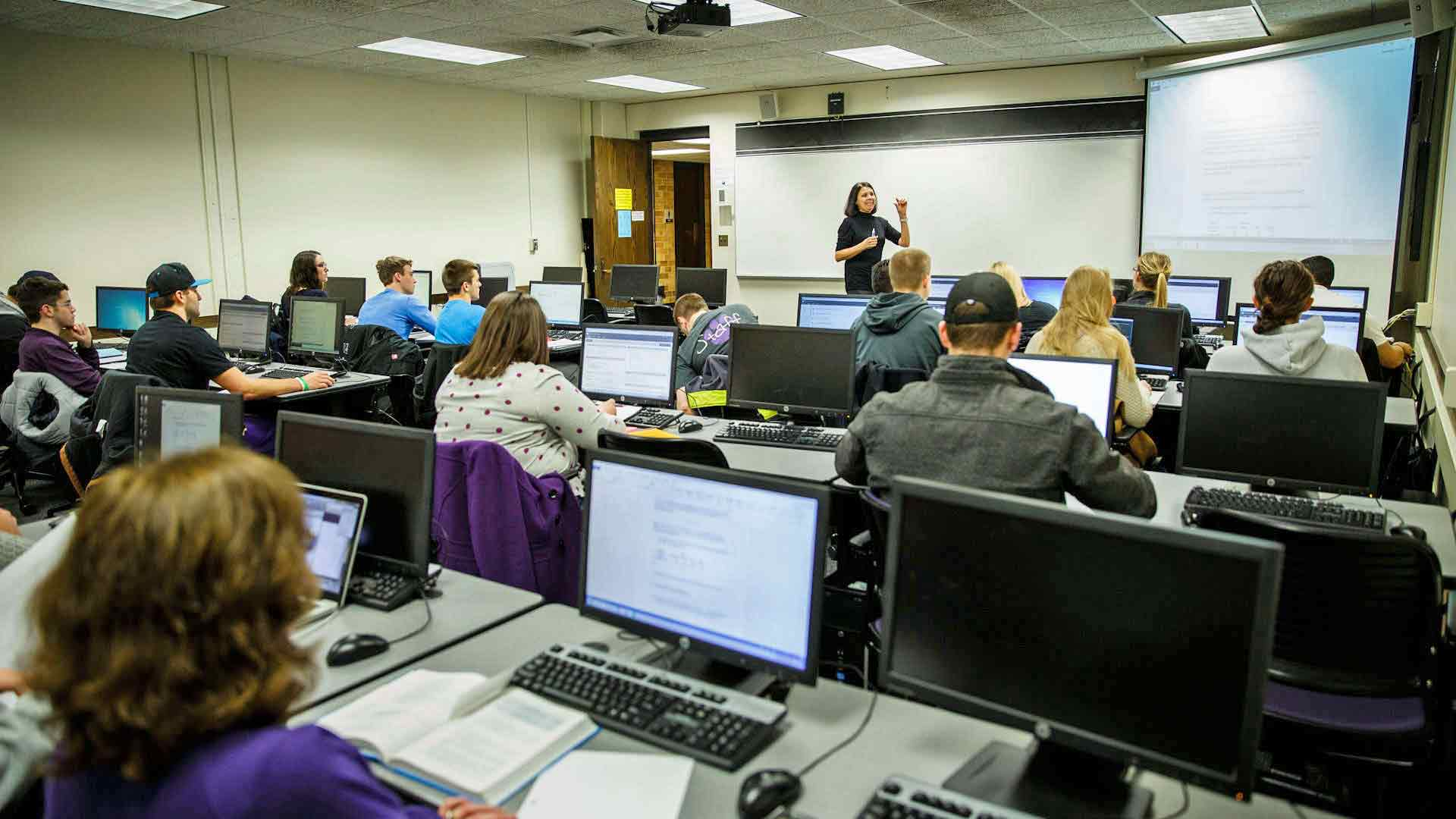 Economics Professor Luz Saavedra teaches an Economics Forecasting class in an O'Shaughnessy Education Center classroom.