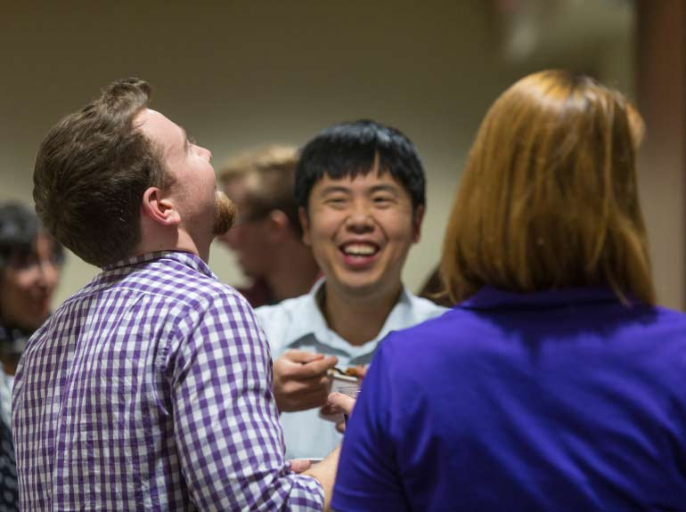 Students mingle with economics faculty at the annual Chili Fest.