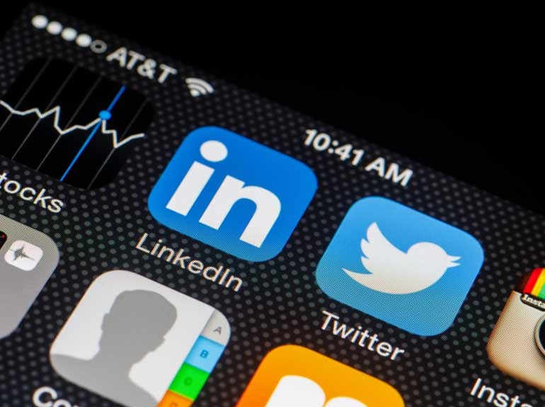Stock photo of an iPhone screen featuring apps for LinkedIn, Twitter and Instagram.