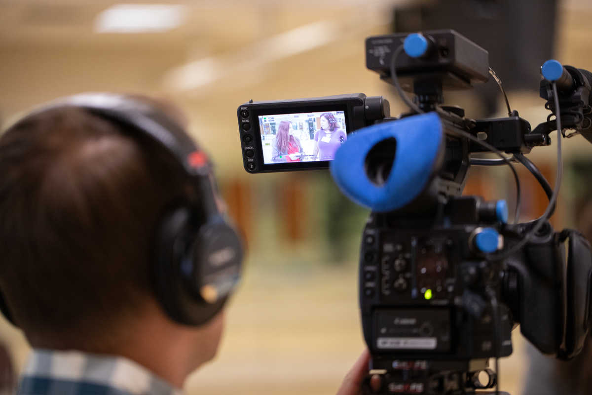 A ThreeSixty Journalism student works a video camera during the annual summer camp.