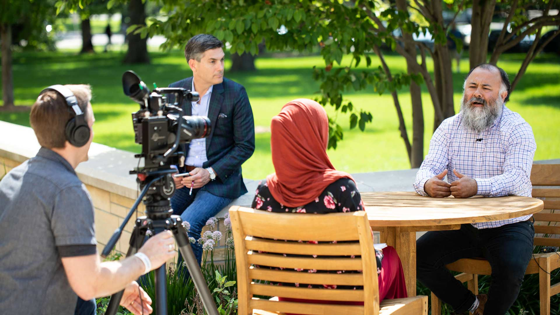 A ThreeSixty Journalism student interviews a person as part of the annual summer camp.