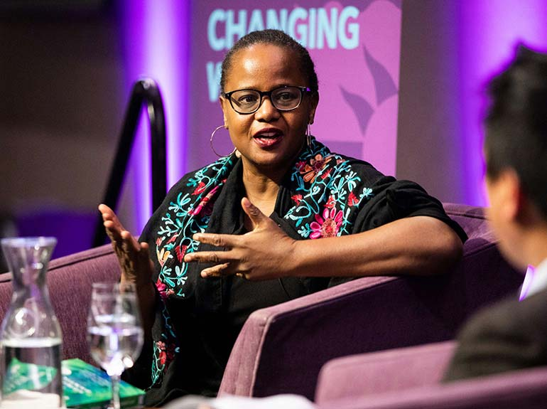 Acclaimed author Edwidge Danticat speaks with Dr. Chris Santiago during an on-campus event.