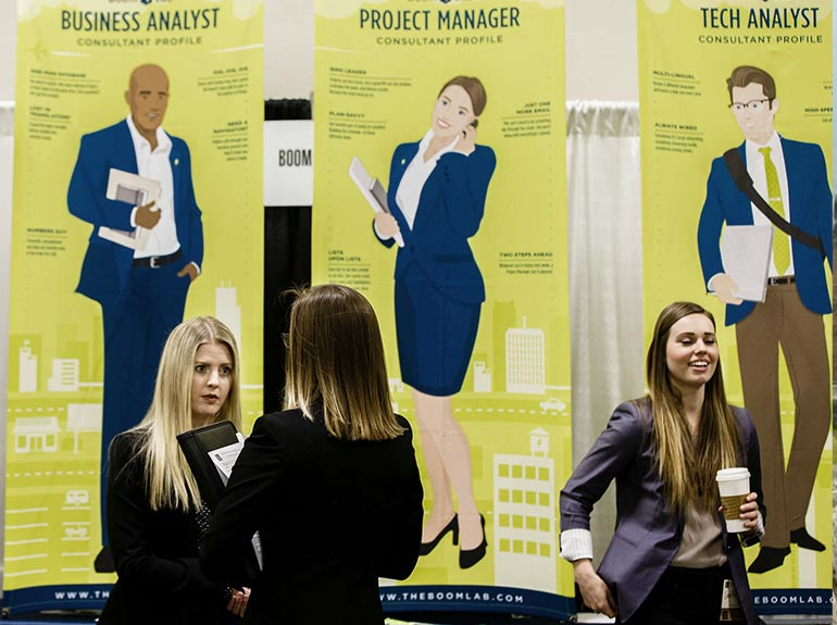 A student speaks to a recruiter at a job fair.