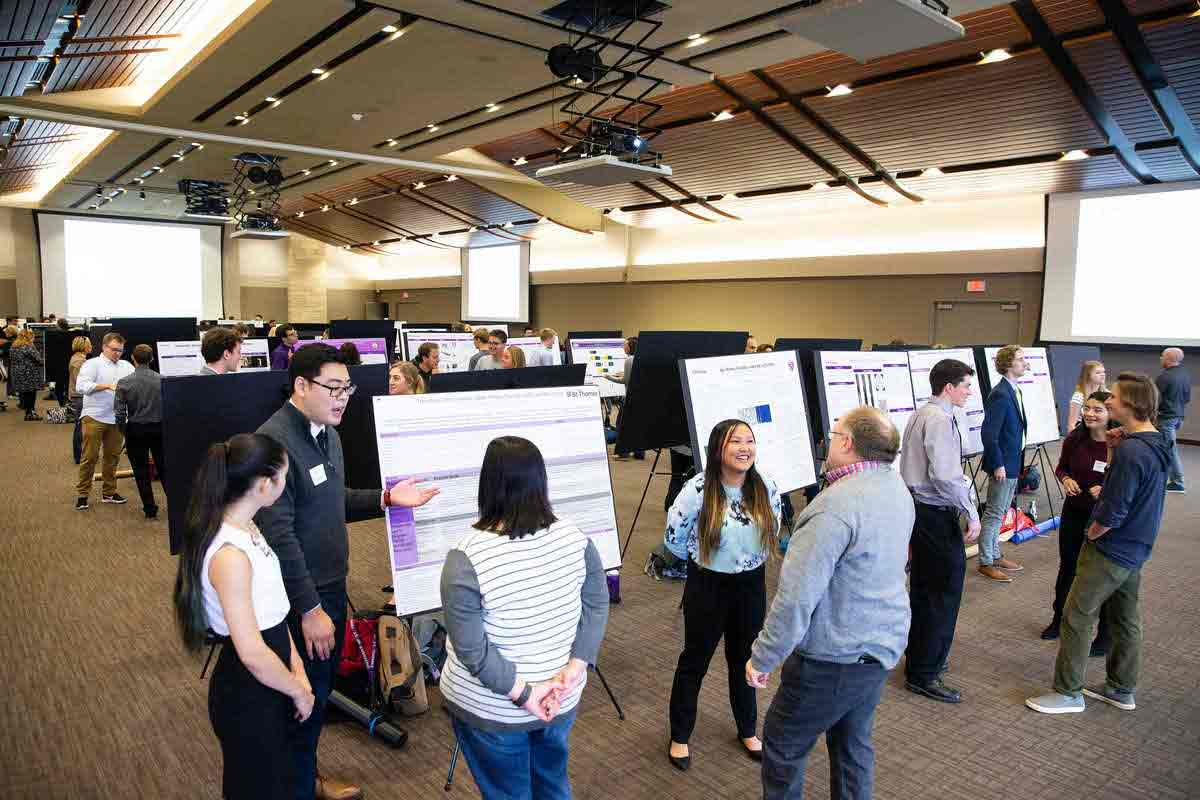 Students presenting capstone projects in Woulfe Alumni Hall