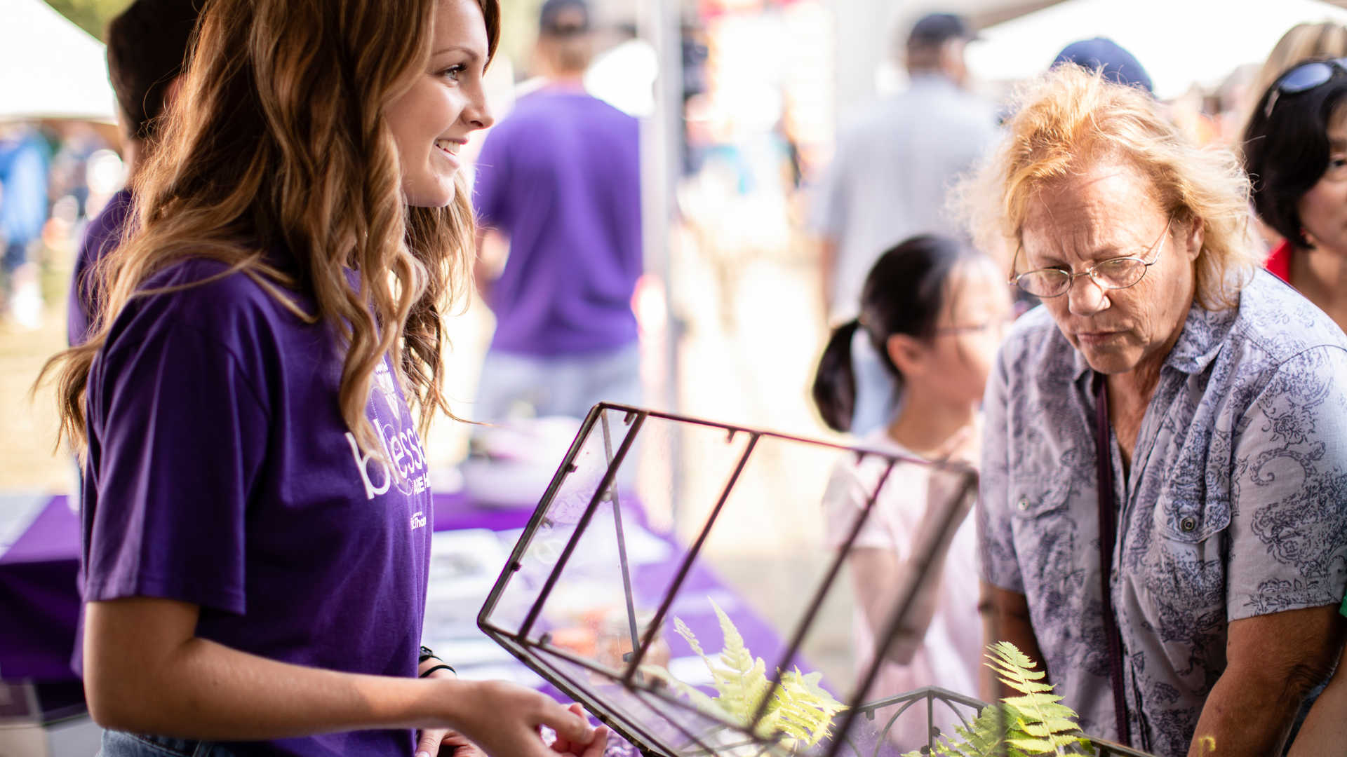 A St. Thomas student speaks with a visitor at the State Fair
