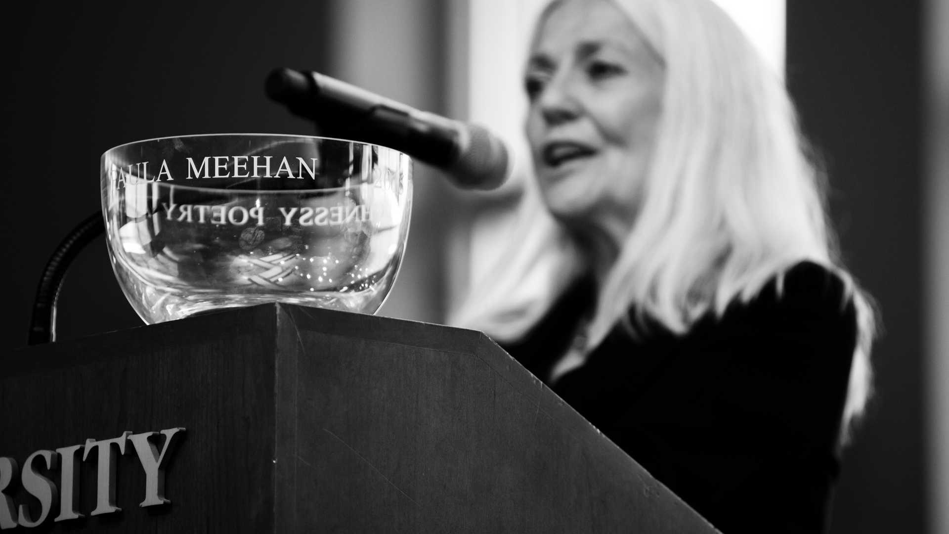 Paula Meehanaccepts award at the Irish Poetry Society Reception.
