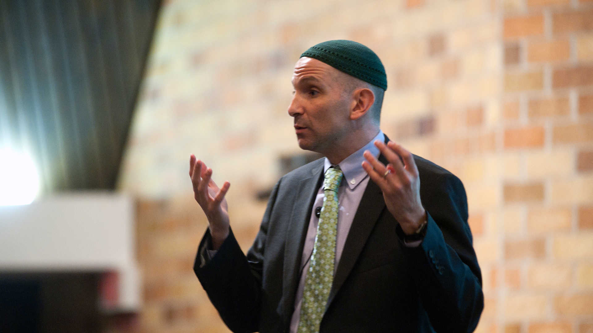 Rabbi Will Berkowitz speaks at an event.