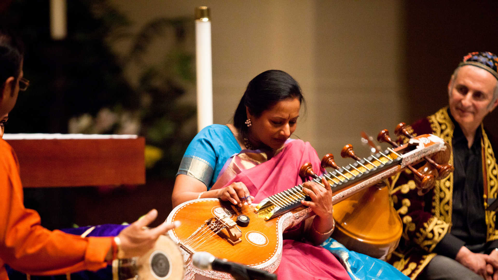 A Hindu musician plays an instrument during a concert on the St. Thomas campus.
