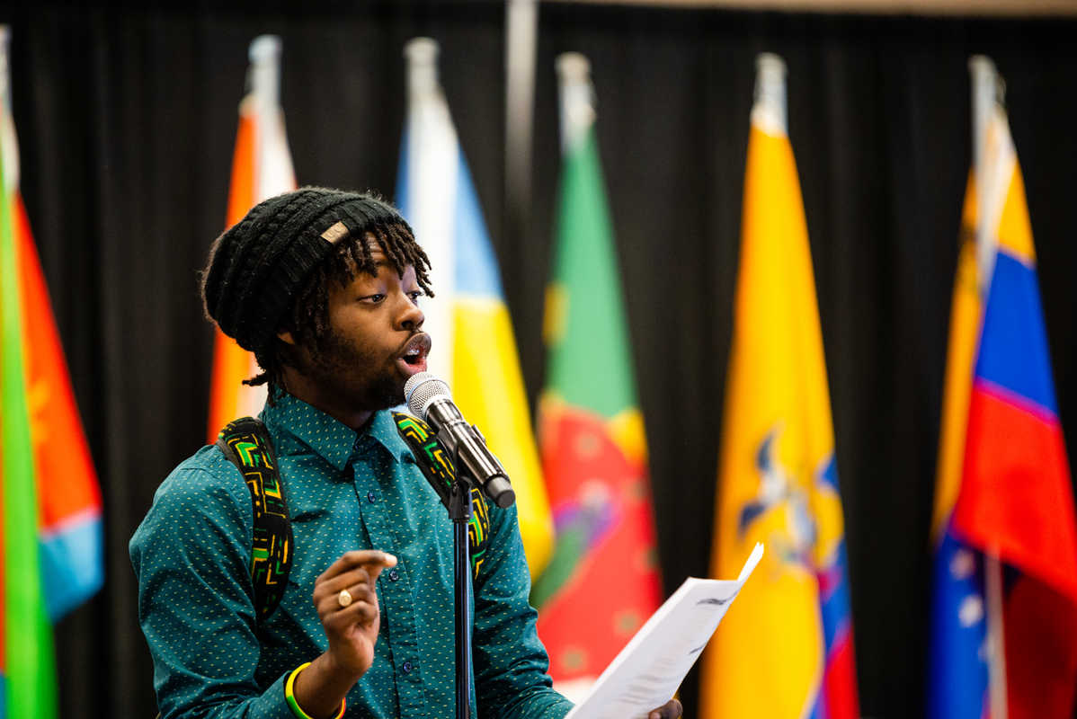 Keanu Daley performs his poem about Jamaica during International Dinner.