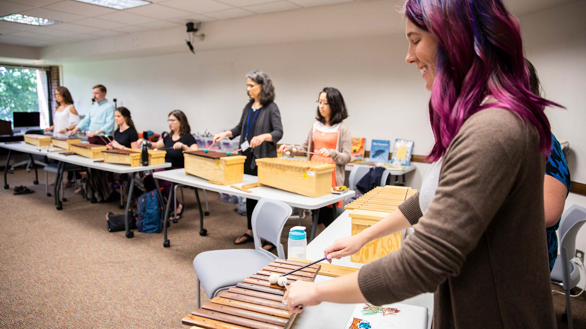Students learn to play the xylophone.