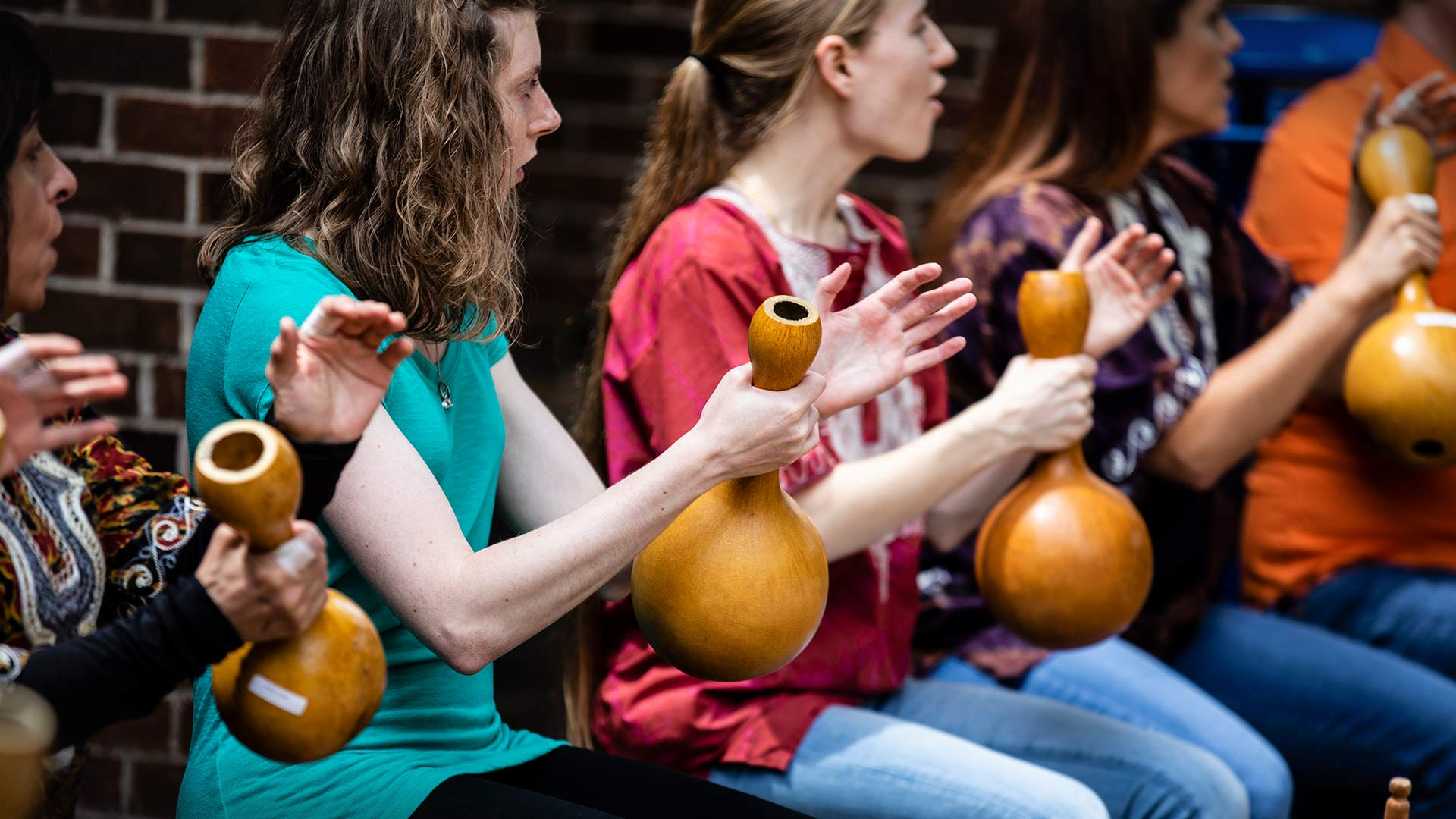 Student playing gourds.