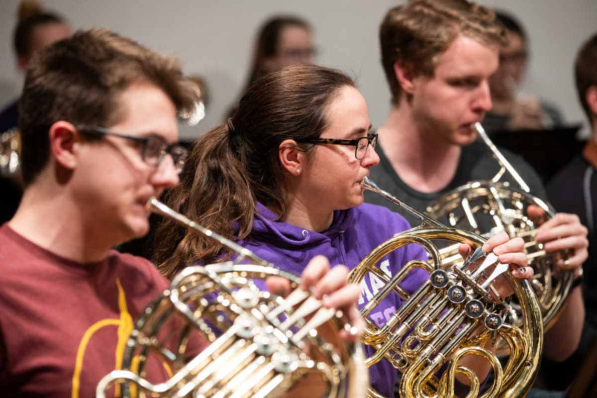 French horn players rehearse during Symphonic Band class.