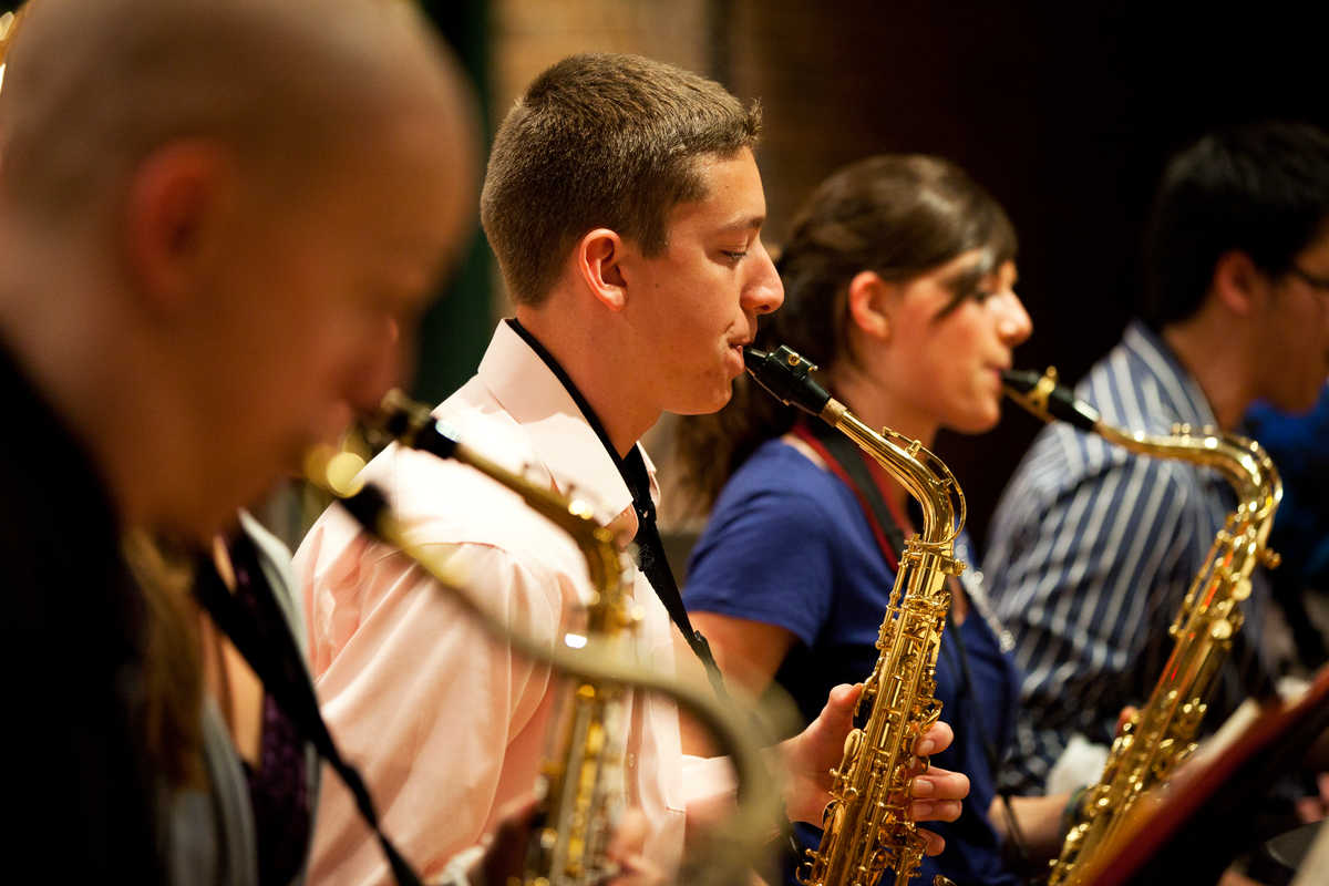 Students play the saxophone during a concert.