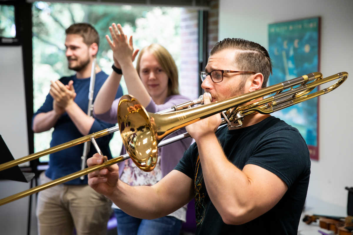 Graduate music students play instruments in a course instructed by Matthew George.