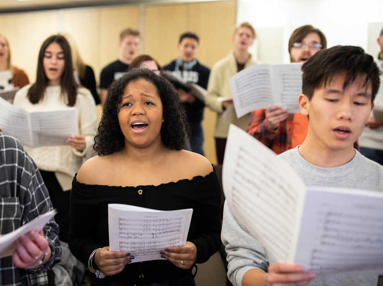 Choral students rehearsing during class.