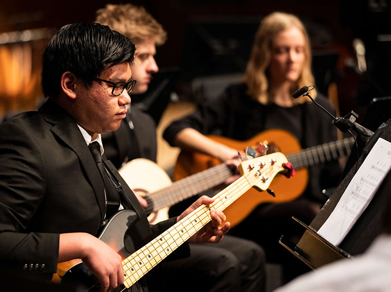 The Guitar Ensemble performs during the annual St. Thomas Christmas Concert.