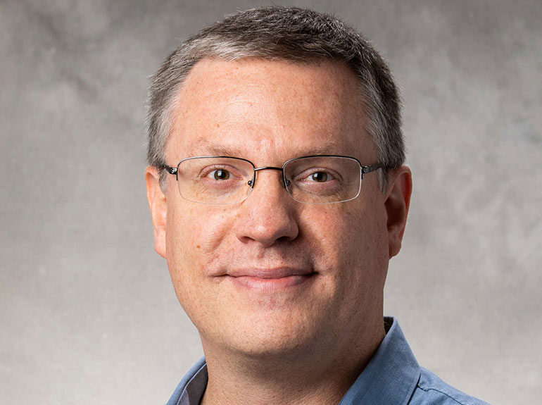Photo of physics faculty member Adam Green.