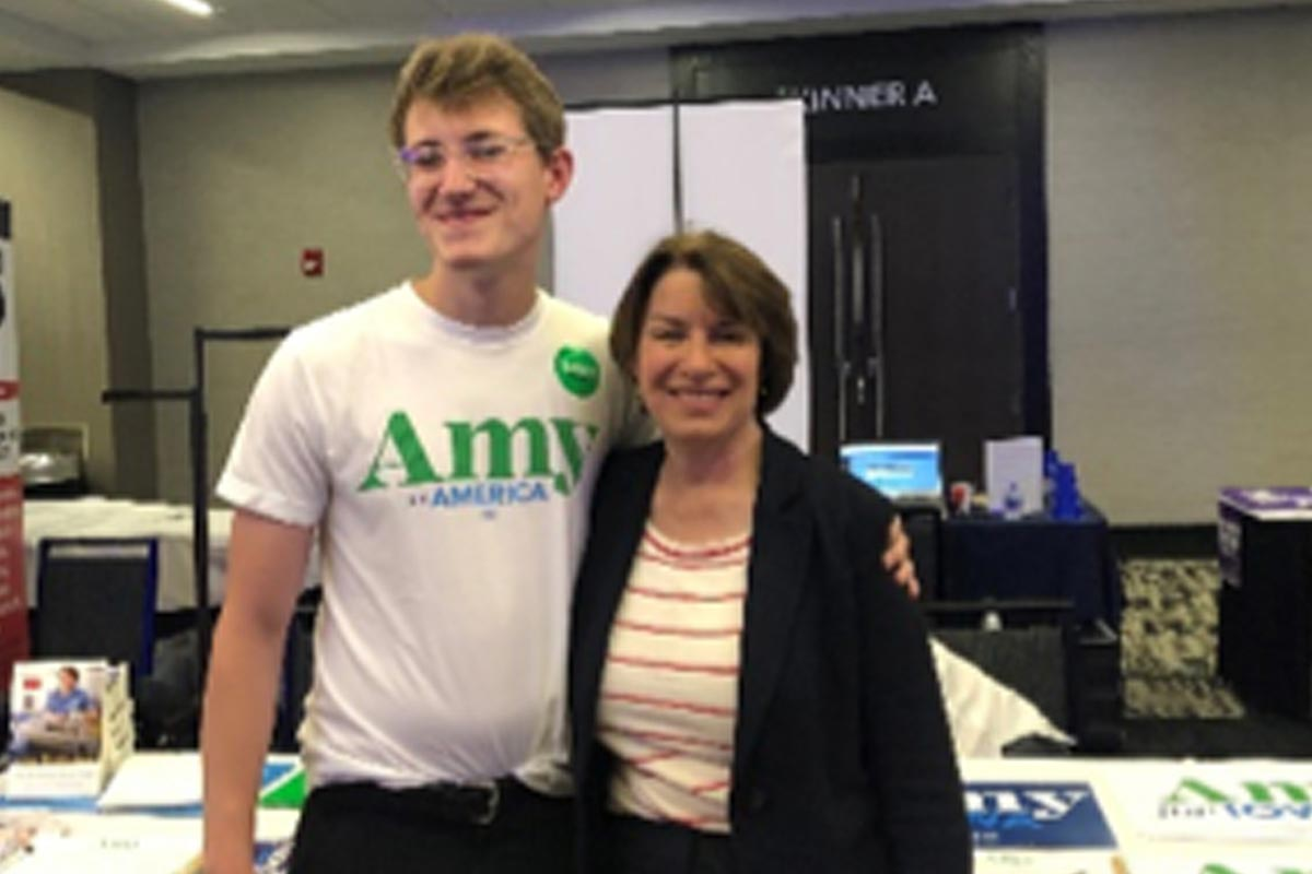 Photo of St. Thomas student Will Myers with U.S. Senator Amy Klobuchar.