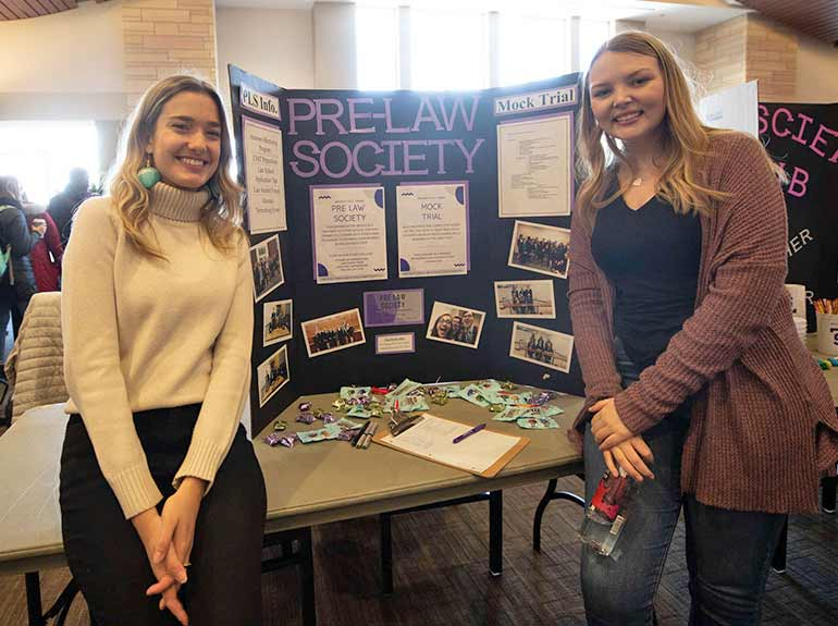 Students from Pre-Law Society pose for a photo at the Spring Activities Fair.