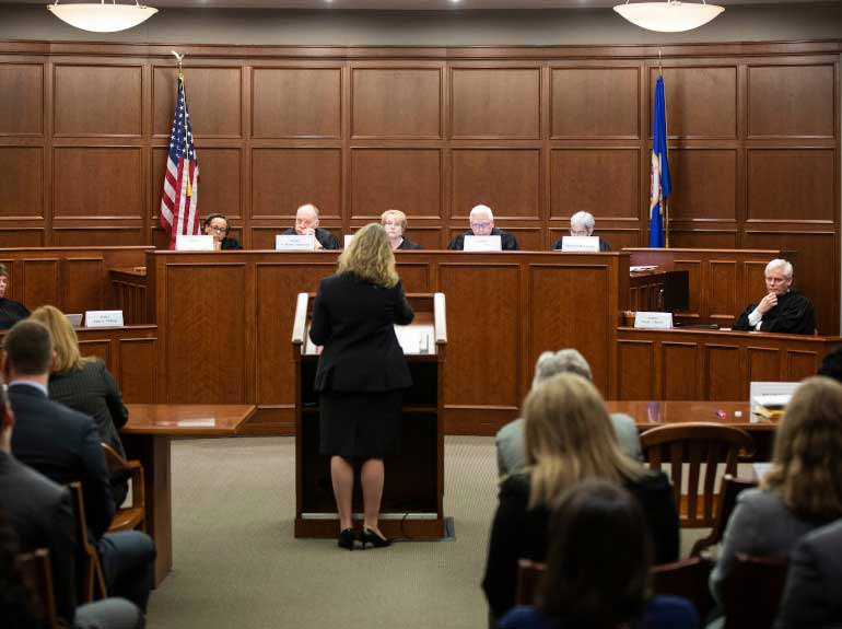 Justices listen to arguments during a visit to the Frey-Moot Courtroom in Minneapolis.