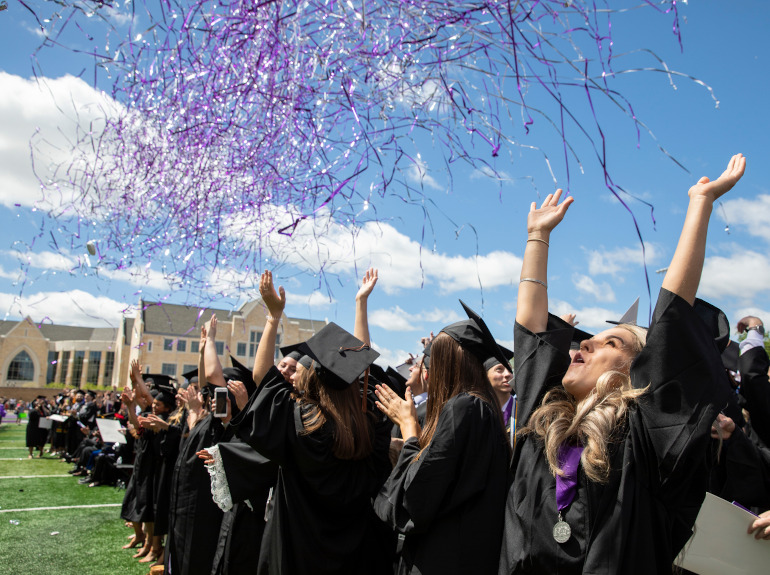 Graduates celebrate as confetti falls around them at the 2019 Undergraduate Commencement Ceremony.