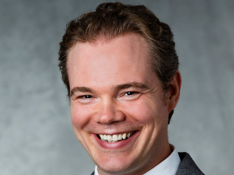 Headshot of Dr. Ryan Bremner.