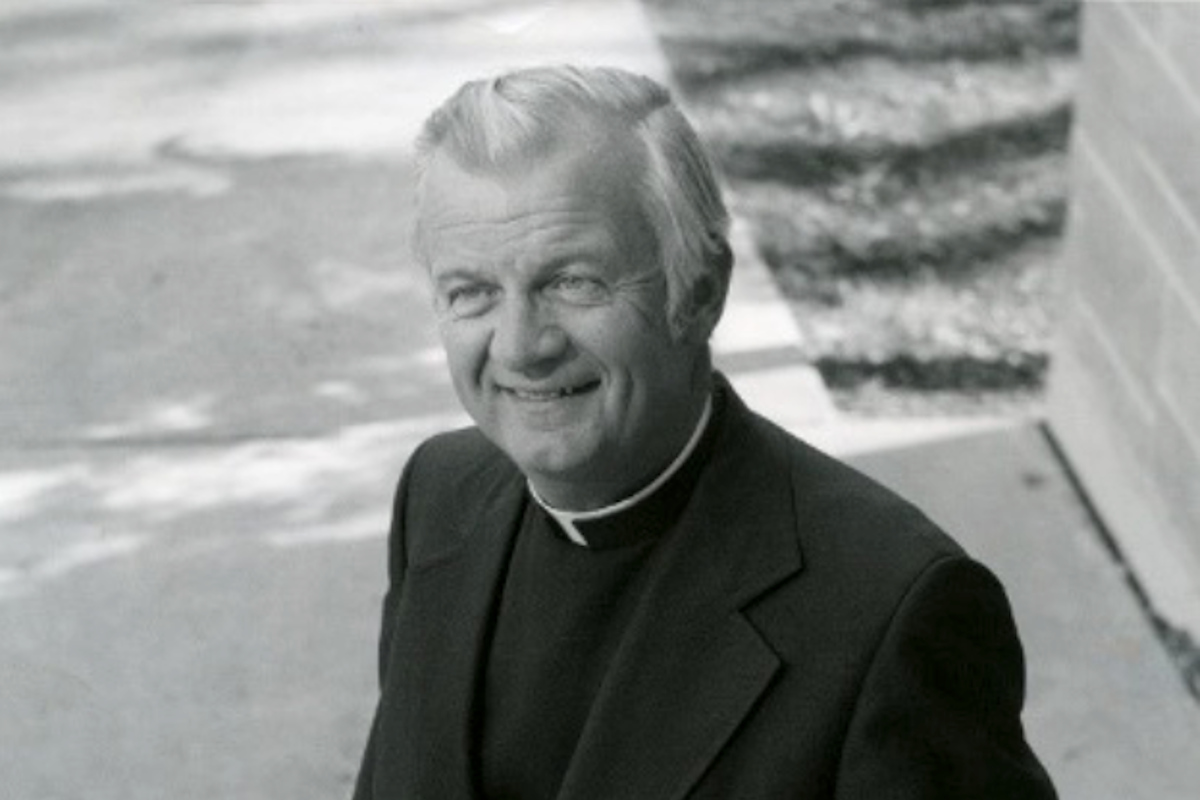 Black and white photo of Catholic priest and former university president Monsignor Terrence J. Murphy.