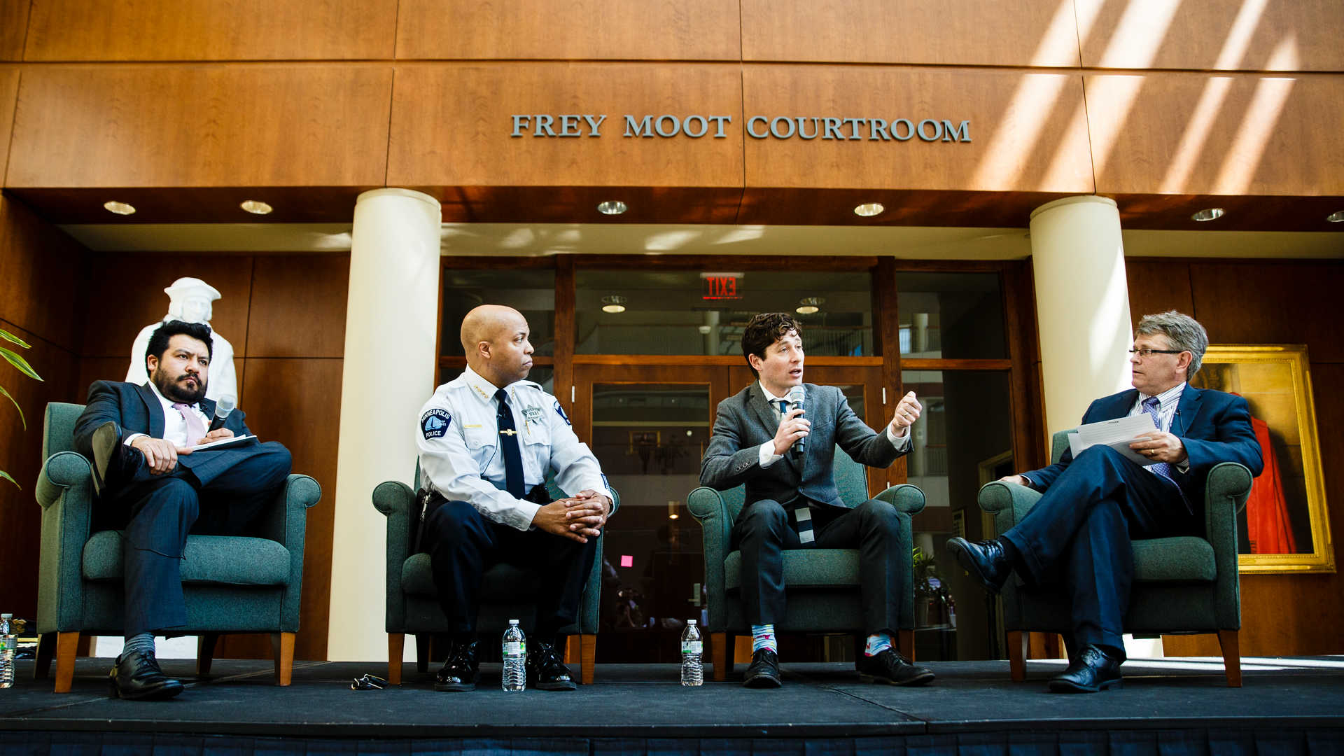 Photo of panel discussion presents at the School of Law.