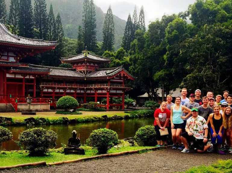 Students posing in front of Pagoda in Hawaii